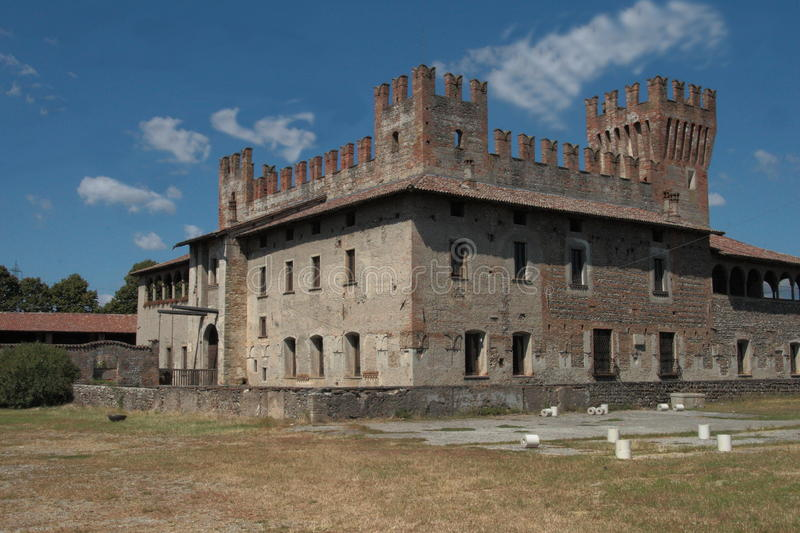 The Castle of Malpaga. Is one of the most important Lombardy buildings of 1300 which, with its intact beauty and invaluable cultural value, dominates an expanse stock photo