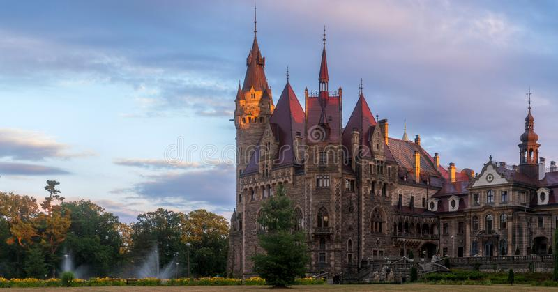 Opole, Moszna, Poland-July 2019:Castle in Moszna in the rays of the rising sun, near Opole, Silesia, Poland. royalty free stock photos