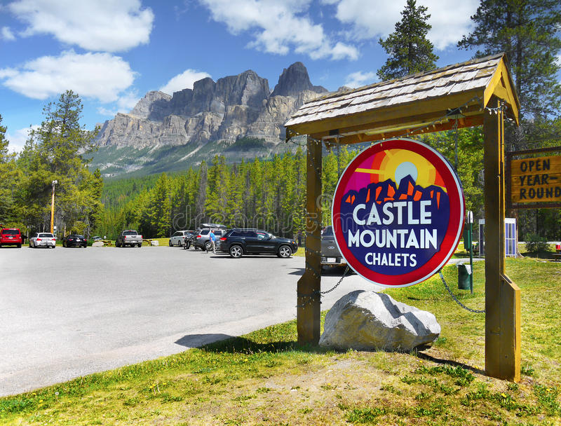 Castle Mountain, Banff National Park. Castle Mountain Chalets sign on the parking lot. Castle mountain is in background stock images
