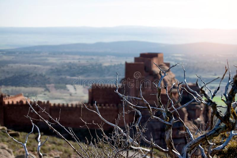Castle on mountain and medieval siege weapons stock photo
