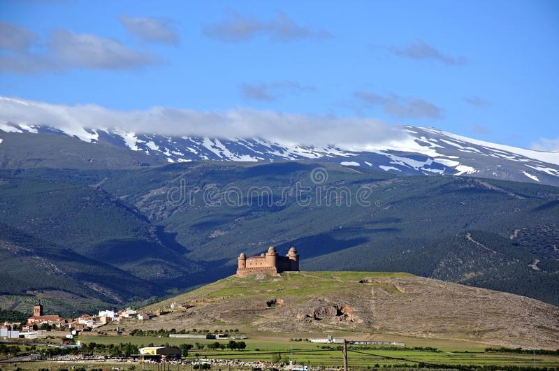 Castle with mountain views, La Calahorra, Spain. Castle with snow capped mountains of the Sierra Nevada to the rear, La Calahorra, Granada Province, Andalucia royalty free stock images