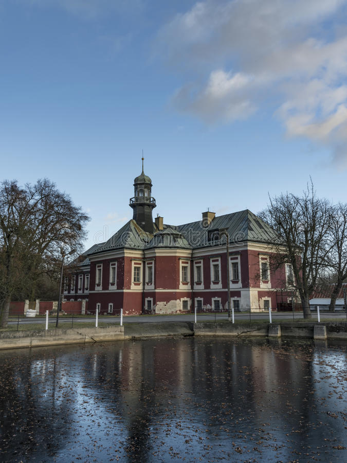 Castle near pond on square in Kokorin village royalty free stock image