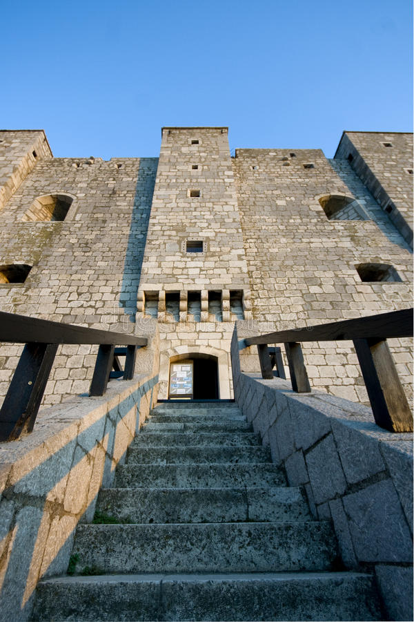 Castle Nehaj main gate. Stairs on the main gate of the castle Nehaj with the visible small windows royalty free stock image