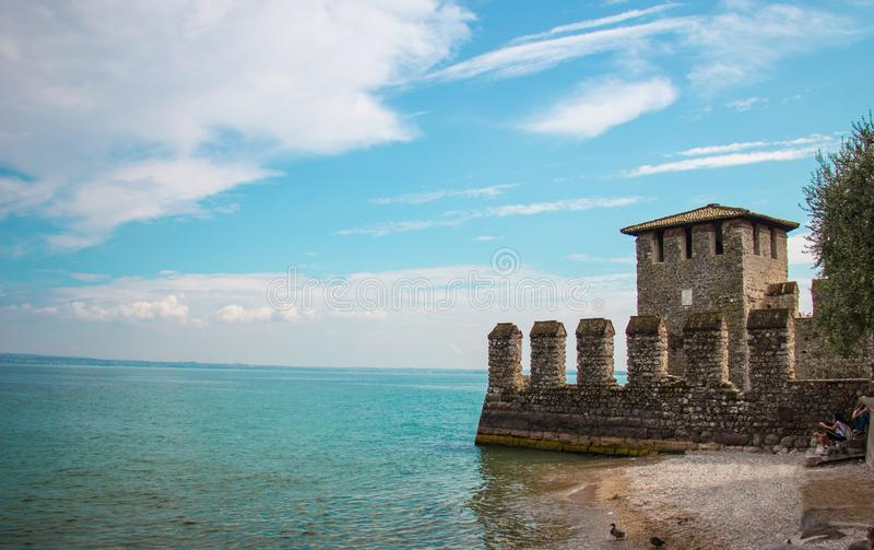 Castle next to the water in Sirmione stock photo