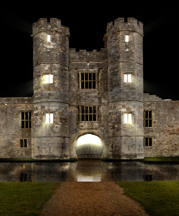Castle at night with moat stock image