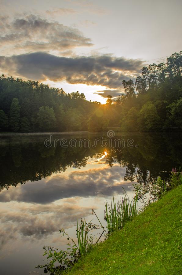 Sunset over the lake. Trakoscan Castle Lake, Croatia. Castle in northwestern Croatia, in Varaždin County near the Slovenian border, about 23 kilometers from royalty free stock photography