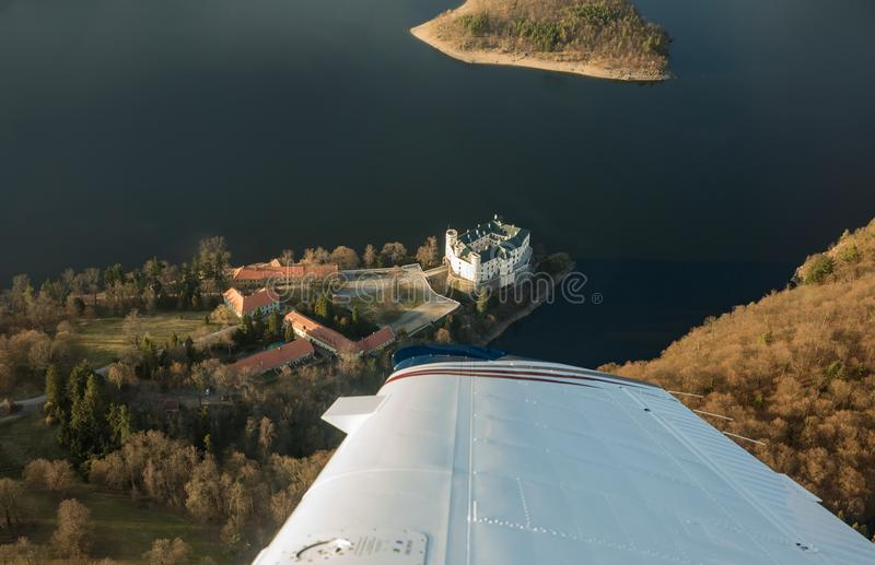 Castle Orlik under Orlik dam, view from airplane, Czech medieval stronghold in the Southern Bohemia, Czech Republic. Castle Orlik under Orlik dam, view from stock photo