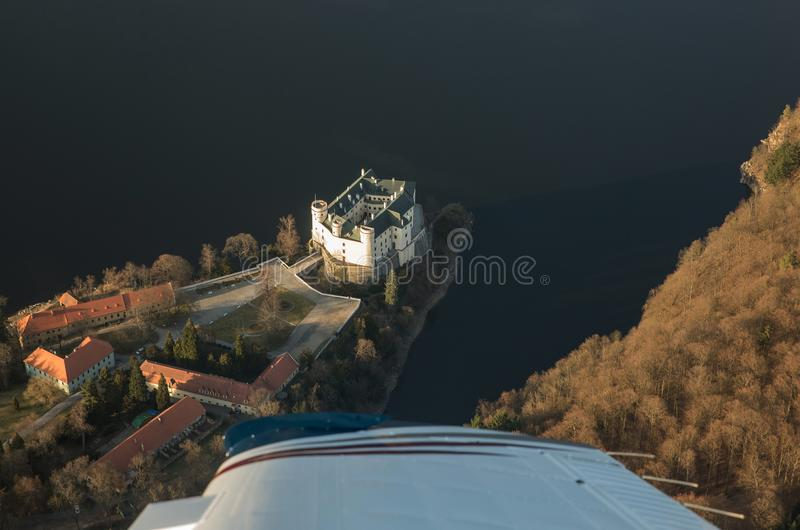Castle Orlik under Orlik dam, view from airplane, Czech medieval stronghold in the Southern Bohemia, Czech Republic. Castle Orlik under Orlik dam, view from royalty free stock images