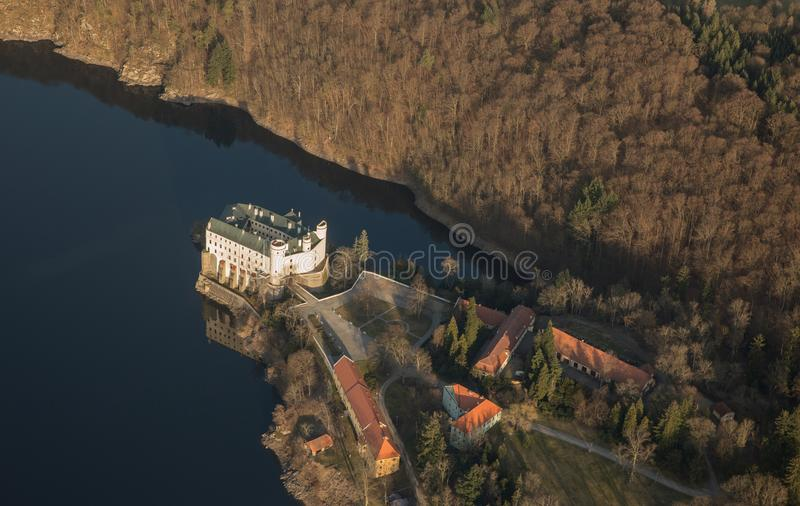 Castle Orlik under Orlik dam, view from airplane, Czech medieval stronghold in the Southern Bohemia, Czech Republic. Castle Orlik under Orlik dam, view from stock photos