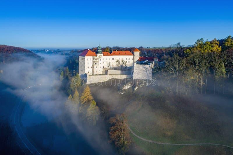Castle Pieskowa Skala near Krakow, Poland. Historic castle Pieskowa Skala near Krakow in Poland. Aerial view in fall at sunrise in morning fog stock photos