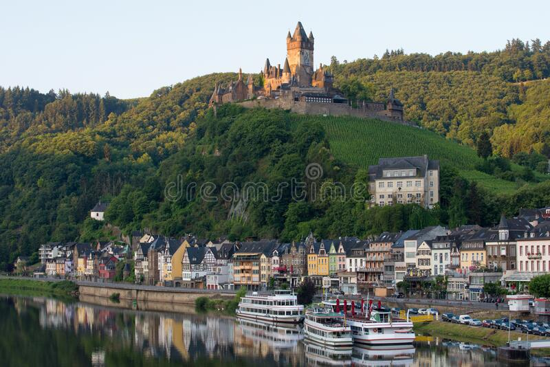 Castle Reichsburg sits above the medieval town of Cochem on the Mosel River, Germany royalty free stock photo