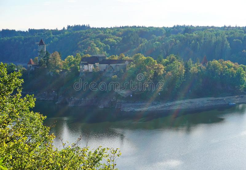 Castle on a river bank royalty free stock photography