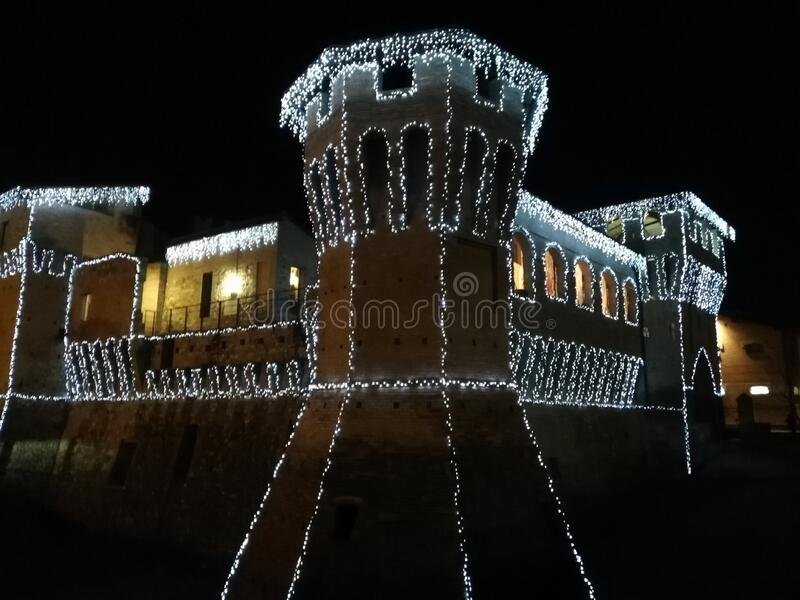 The castle of Rocchetta di Castellarano Italy adorned for Christmas and New Year,the contours of the illuminated castle photograph stock photos