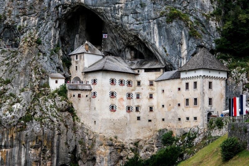 Castle in rock in Slovenia. Predjama Castle, Slovenia`s famous castle stock photos