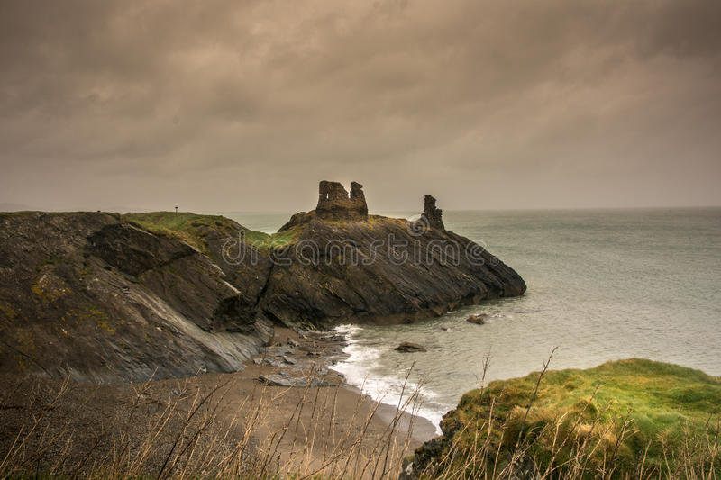 Castle ruin on cliff overlooking the sea. The historic Norman Black Castle ruin is an ancient fortress standing on a rocky promontory overlooking the Irish Sea royalty free stock photography