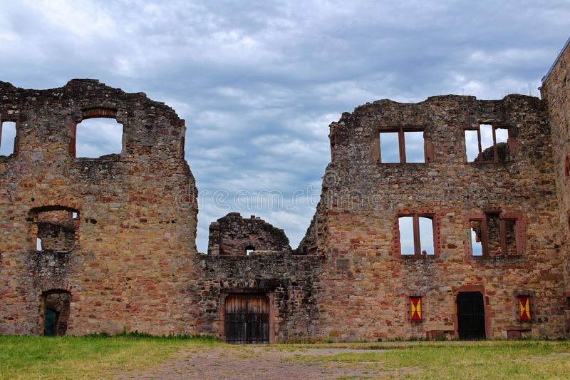 Medieval castle ruin eerie courtyard. In the courtyard of a castle ruin which was burnt down. Medieval architecture in Germany stock photo