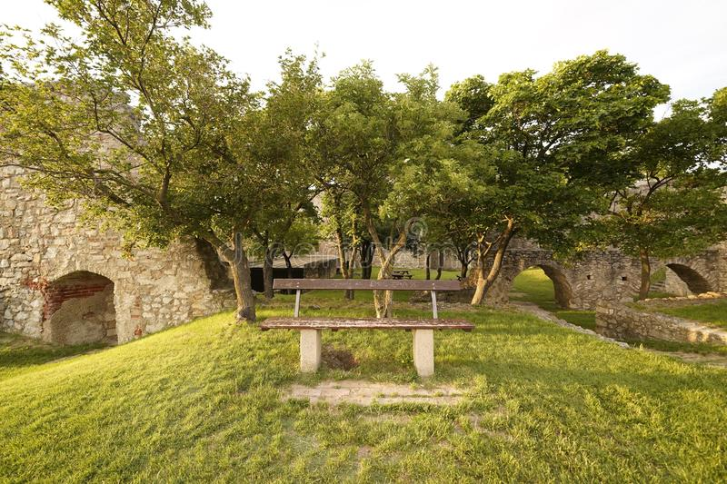 Bench and castle ruins stock images