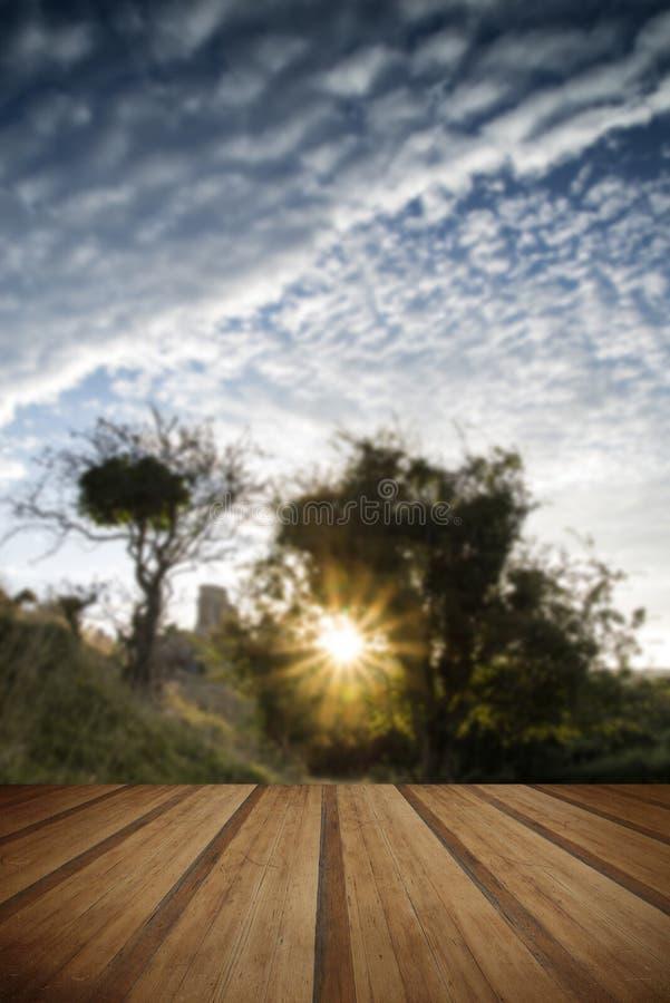 Castle ruins landscape at sunrise with inspirational sunburst be royalty free stock photos