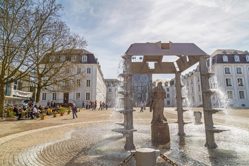Castle of Saarbrucken. SAARBRUCKEN, GERMANY - APRIL 10: The castle of Saarbrucken with a fountain in the foreground on a sunny spring day. April 10, 2015 in royalty free stock photography