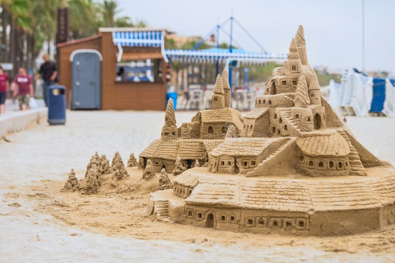 Castle of sand on the beach. Concept: unrealized dreams. stock image
