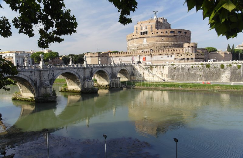 Castle Sant Angelo and Tevere River - Rome. Bridge and Castle Sant Angelo in Rome, Italy. The circular shape of the castle walls and the arches of the bridge royalty free stock images