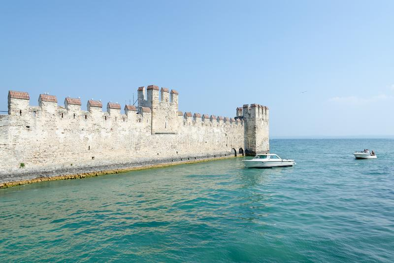Castle of Scaligers second half of 12th - early 13th century on shore of Lake Garda in resort town of Sirmione, Italy. Castle of Scaligers built in second half stock image