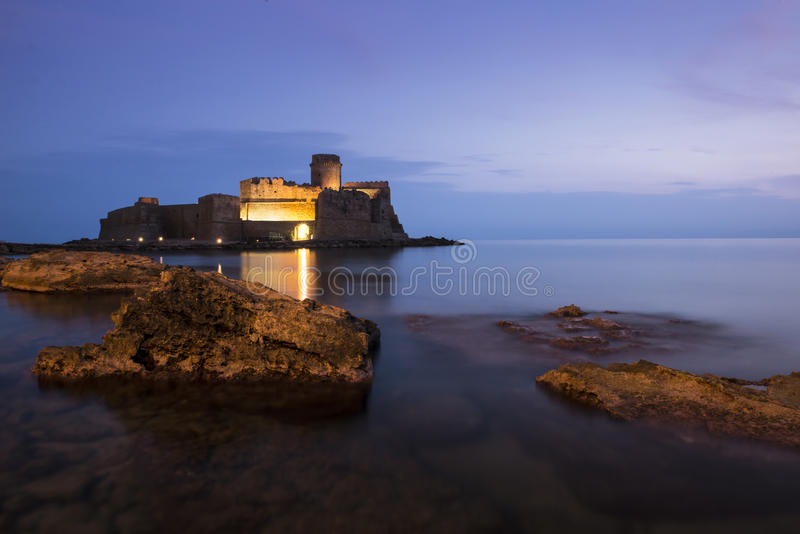 Castle in the sea in Le Castella town, Calabria, Italy royalty free stock photography