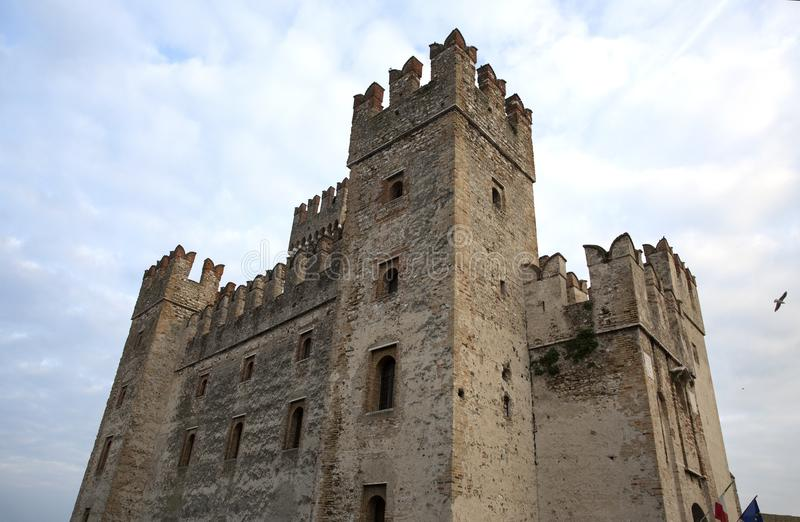 Castle in Sirmione. View to the medieval Rocca Scaligera castle in Sirmione town on Garda lake, Italy. Scaliger Castle 13th royalty free stock photo