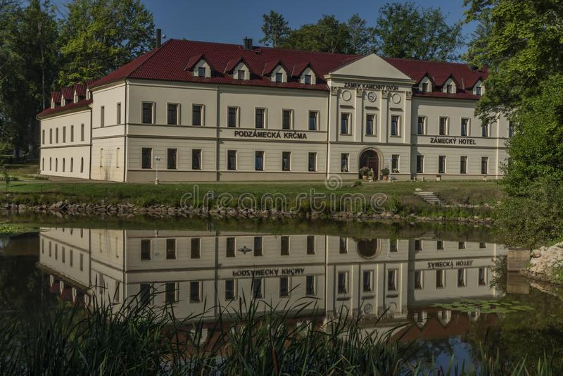 Castle with small pond and tree around in West Bohemia in summer royalty free stock images