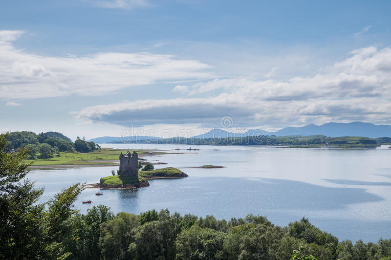 Castle Stalker, Scotland. Castle Stalker in the lake Loch Linnhe, Argyll, Scotland. In the background Isle of Mull stock photography