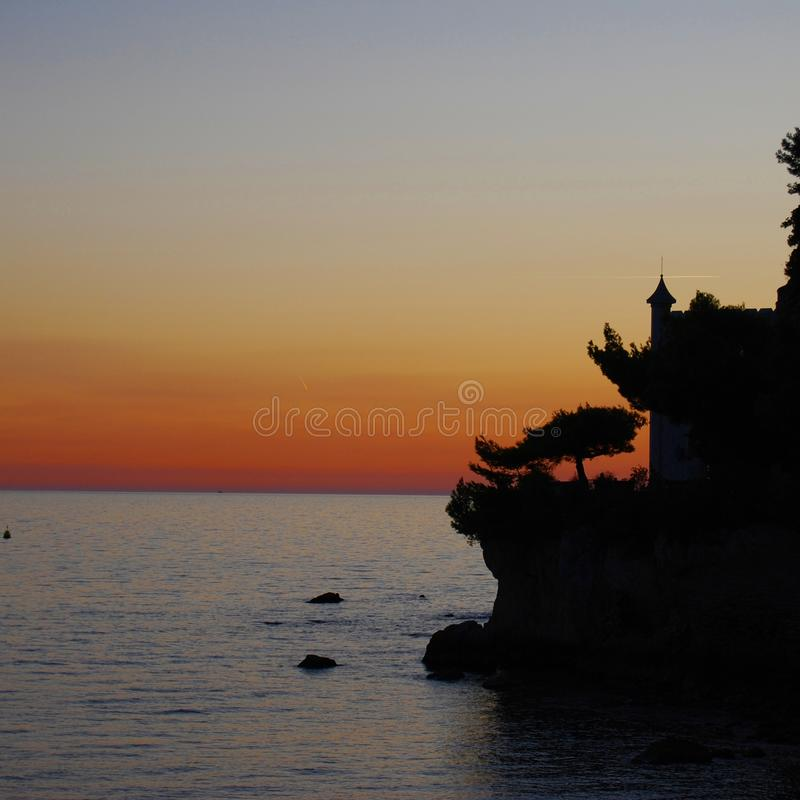Castle in the sunset royalty free stock image