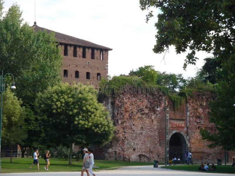 Castle surrounded by Garden. Parco Sempione and Sforza Castle - July 2017 - Milan - Italy stock image