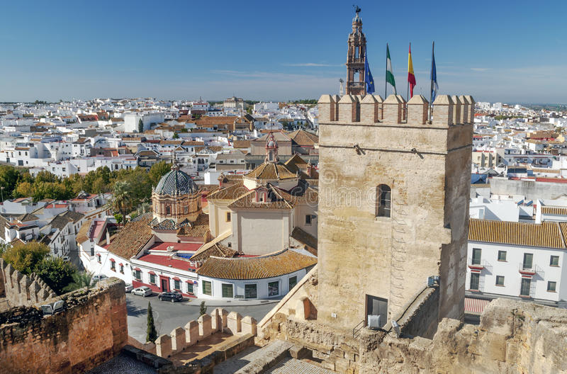 Castle tower of Carmona. Castle tower of the Spanish city of Carmona from where you can see the white houses and the street of Carmona village royalty free stock photo