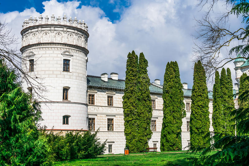 The castle tower houses surrounded by seasonal plants and part o royalty free stock photos