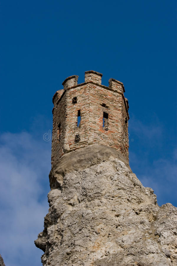 Castle tower on a rock. With a blue sky and clouds in the background. It is Devin castle near Bratislava (Slovakia royalty free stock photos