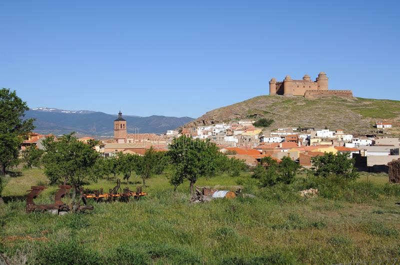 Castle and town, La Calahorra, Spain. View of the castle on the hilltop with town buildings in the foreground, La Calahorra, Granada Province, Andalucia, Spain stock images