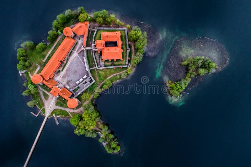 The castle of Trakai as island in lake, aerial top view. The castle of Trakai, aerial top view of historic building and spring forest royalty free stock photo