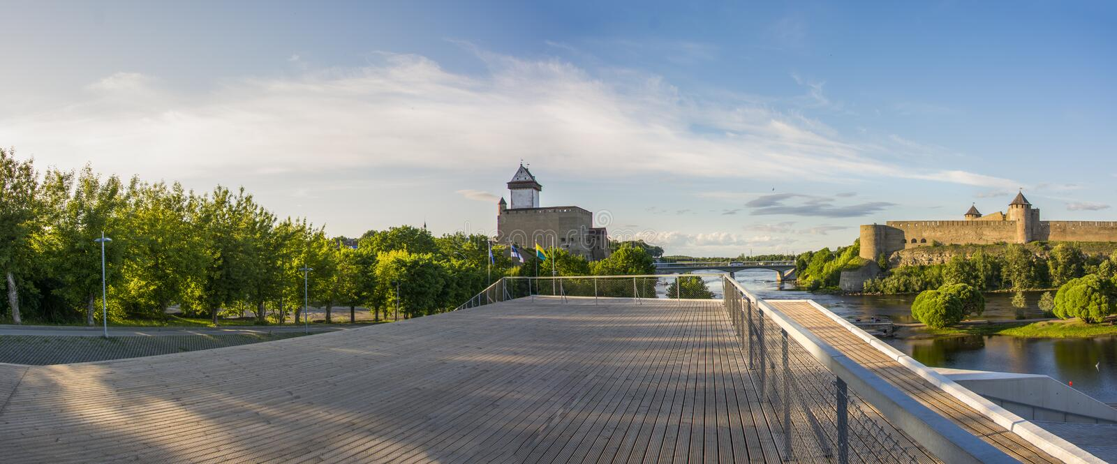 Eastern border of European Union, In Narva Estonia. Eastern Border on European Union in Narva, Estonia. On the left side is Estonian castle on the right side is stock photography