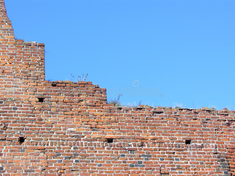 Castle wall and blue sky stock photo