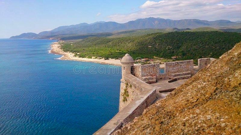 a castle wall on the coastline royalty free stock image