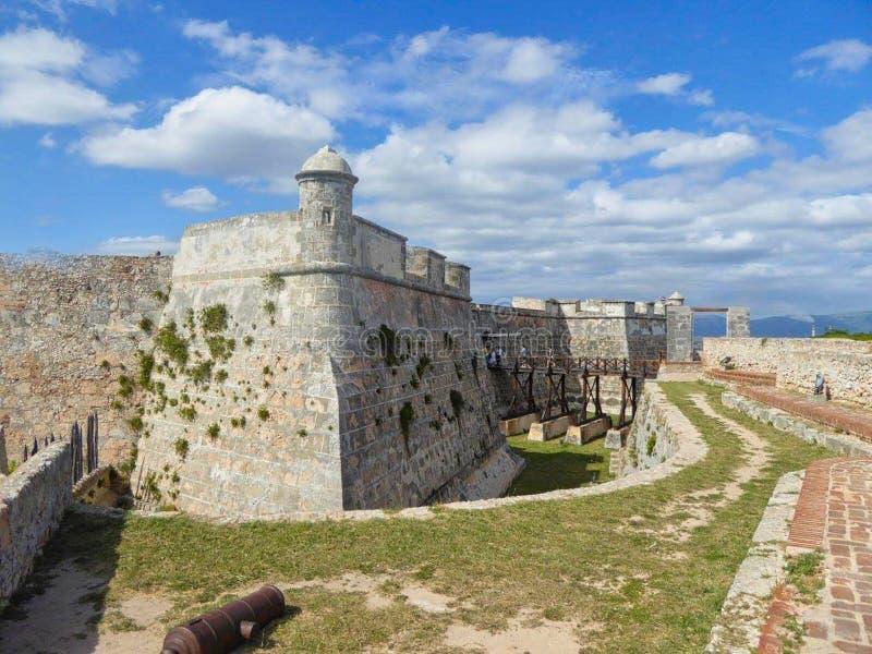 a castle wall on the coastline royalty free stock photos