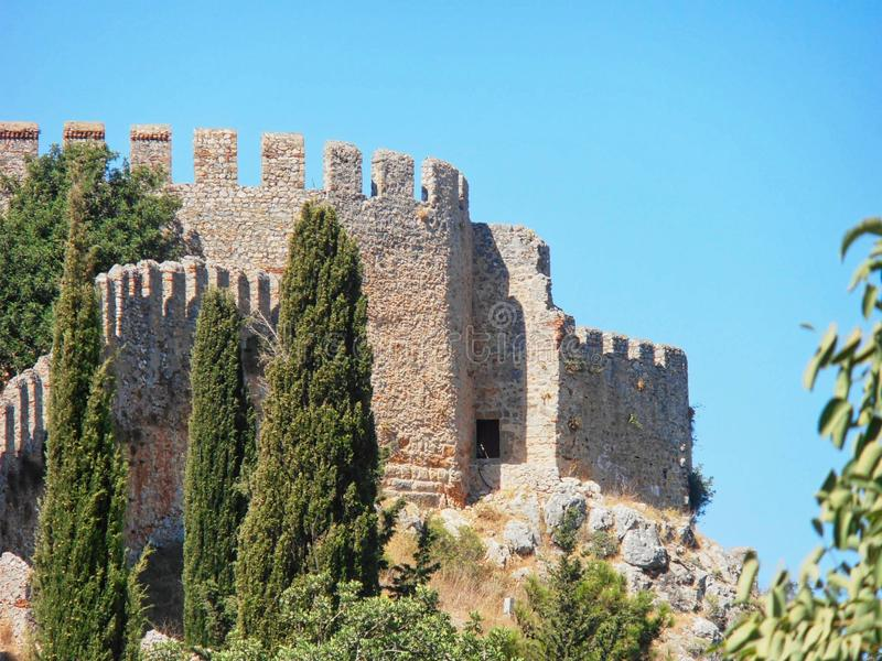 a castle wall on a mountain stock photography
