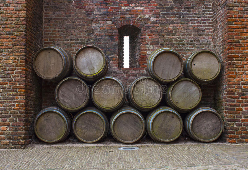 Castle wall porthole and barrels royalty free stock photos