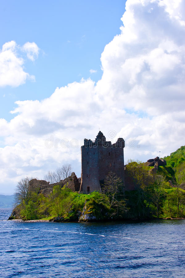 Castle watchtower on the lake shore. Loch ness, scotland, May 2011 royalty free stock photos
