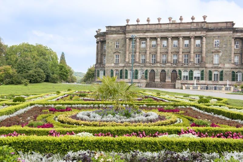 Wilhelmshoehe Castle, Kassel, Germany. Flowerbeds in front of Castle Wilhelmshoehe on Mountain Park in Kassel, Germany stock photo