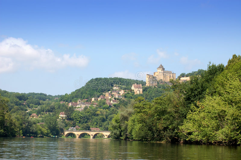 Castlenaud Chateau and Dordogne. The chateau of Castlenaud high above the Dordogne river in France royalty free stock photography