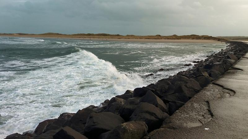 Castlerock Northern Ireland. Beautiful ocean wave breaking on the background of land stock images