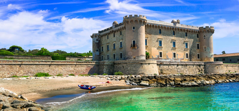 Medieval Castello Palo Odescalchi in Lazio, Italy. Castles of Italy - medieval Castle Palo Odescalchi and the beautiful beach stock image