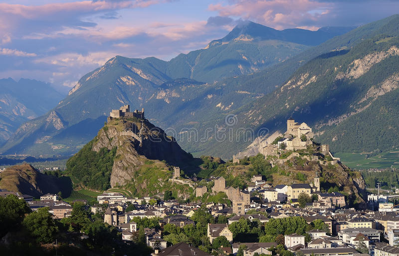 Castles Valere and Tourbillon, Sion, Switzerland in the evening light. The medieval castles Valere and Tourbillon and the town of Sion Switzerland in the evening royalty free stock photos