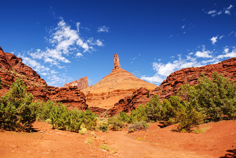 Castleton Tower Rock in Castle Valley, Utah. Castleton Tower is a tall sandstone rock formation on protected land in Utah that has been eroded over millennia. A royalty free stock images